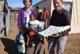 2010; BigShoe Lufthansa; Prof. Frank Graewe from Smile Foundation South Africa and little Inganathi before his medical operation