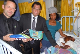 2011; Dr. Danny Jordaan visting Kgosto in the hospital (Johannesburg) and Dr. Igor Wetzel with mother from Kgosto (Malebo Molekoa)