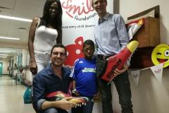 9 year old Sibabalwe Mpingelwani _ Prof. Frank Graewe and Dr. Alexander Zuehlke_ Mirriam Ngomani (BigShoe South Africa)