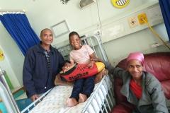 9-year-old-Sibabalwe-Mpingelwani-with-parents-and-BigShoe